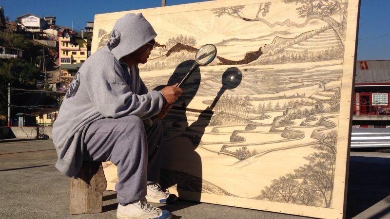 هنر با یک ذره بین و اشعه خورشید